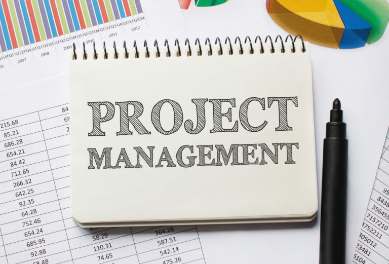 Notebook with Toolls and Notes about Project Management