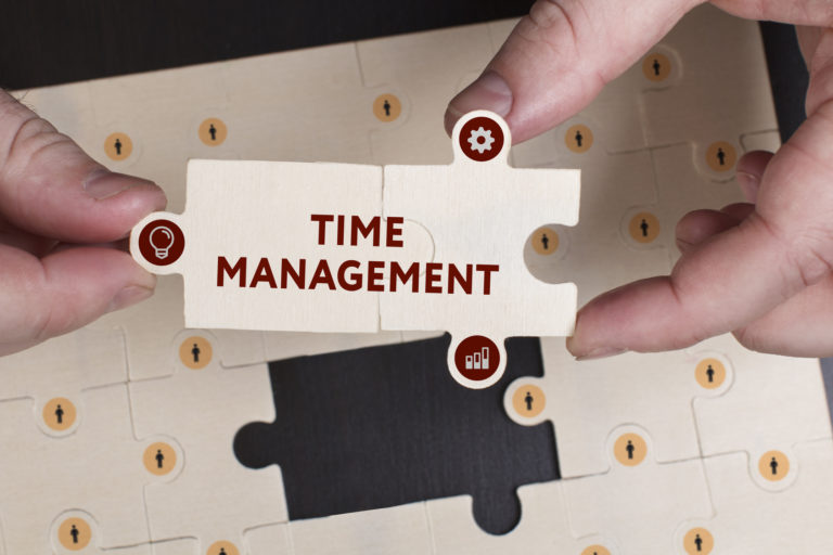 Business, Technology, Internet and network concept. Young businessman shows the word: Time management