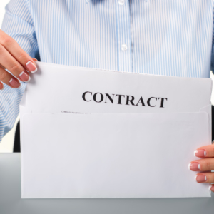 Woman takes contract from envelope. Businesswoman taking contract from envelope. This is for me. Truly thrilling moment.